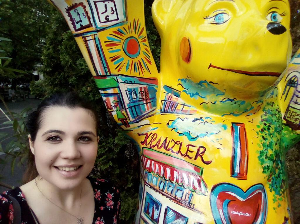 Volpato Elena (English-Italian translator) in Berlin next to a yellow plastic bear.